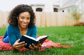 image of woman reading in garden